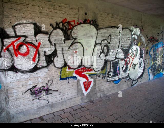 Graffitti under canal bridge - Stock Image
