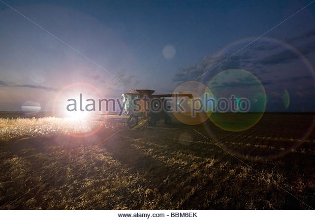 Lens flare of truck headlights combining lentils at night - Stock Image