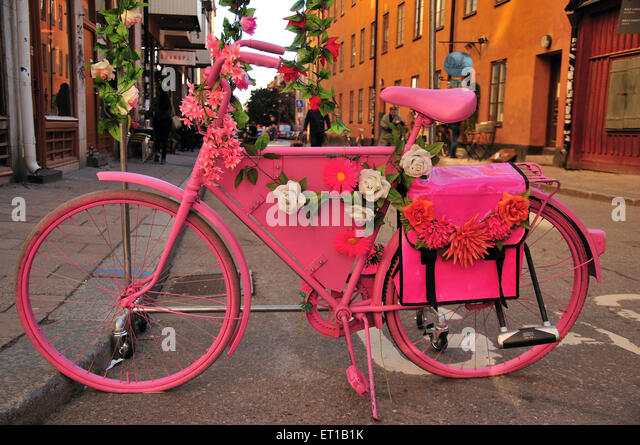 pink bicycle decorated flower Stockholm Sweden - Stock Image