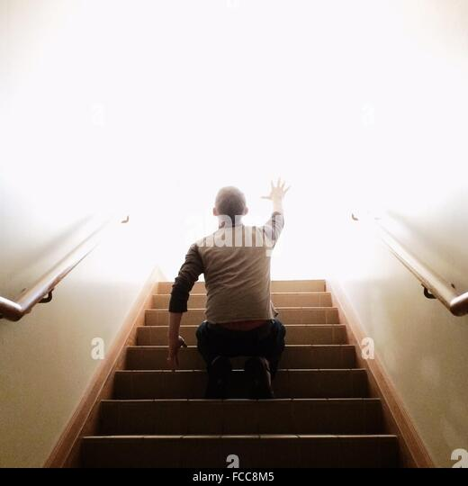 Low Angle View On Man On Stairs - Stock Image