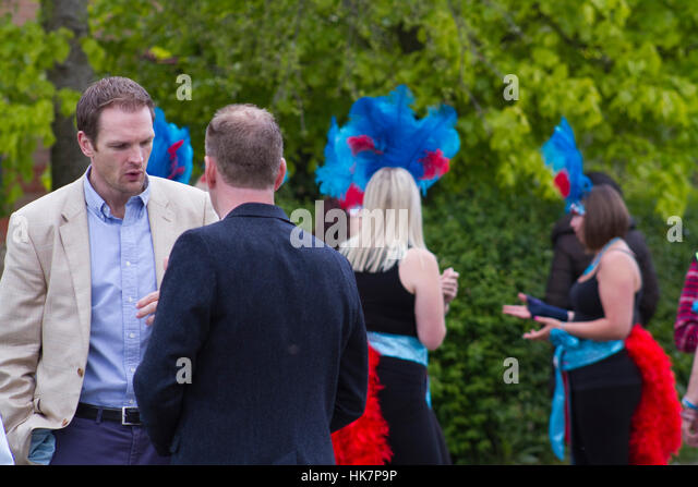 MP Dr Dan Poulter far left at the Framlingham Gala, Suffolk School of Samba dancers behind - Stock Image