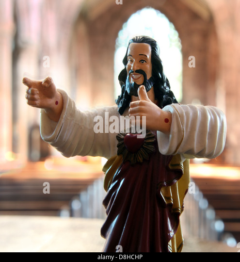 Buddy Christ statue in a catholic church, acceptable face of christianity from the film Dogma - Stock Image