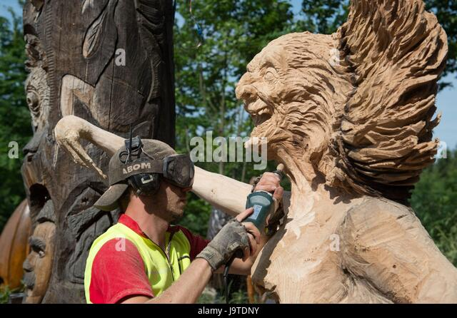 Chainsaw artist carving stock photos