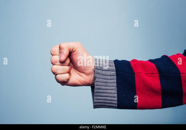 Young man clenching his fist - Stock Image