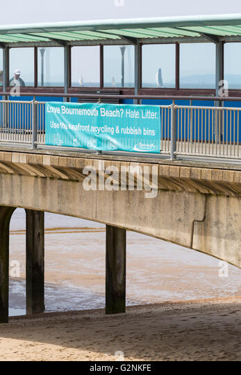 Love Bournemouth beach? Hate litter? Use the seafront recycling & rubbish bins - banner on Boscombe pier - Stock Image