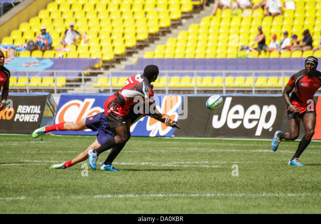 Moscow, Russia. 30th June 2013. Oscar Auma of Kenya passes the ball mid tackle to team mate Humphery Kayange during - Stock Image