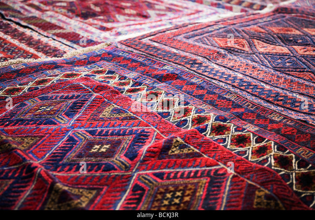 Design on rug in market - Stock Image