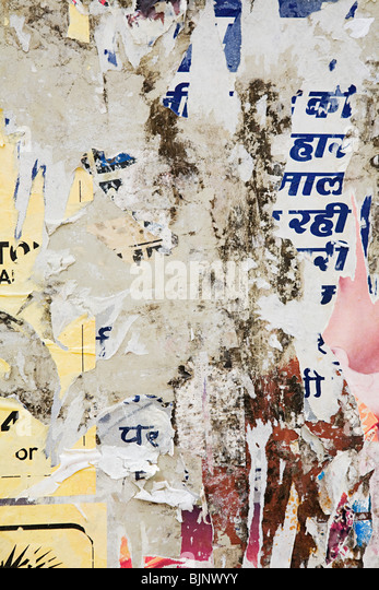Torn posters on a wall - Stock-Bilder