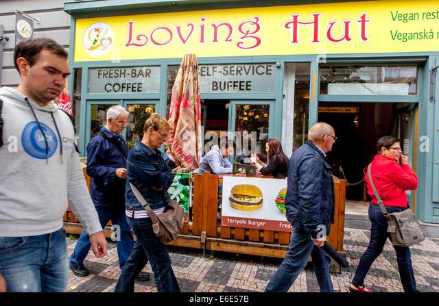 Tourists on Prague Wenceslas Square, sidewalk, Loving Hut, vegan restaurant Prague, Czech Republic,Europe - Stock Image