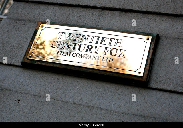 Plaque on Twentieth Century Fox offices in Soho Square, London - Stock Image