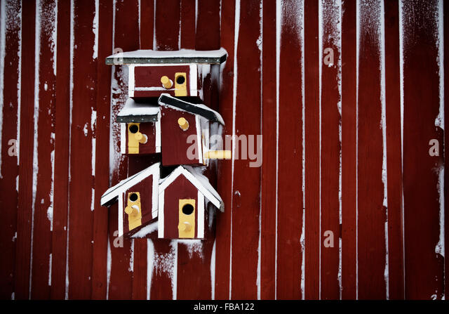 Sweden, Red bird houses - Stock Image