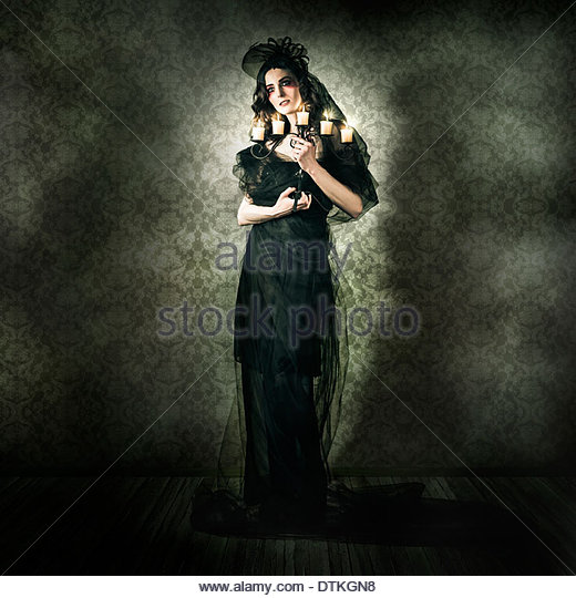 Dramatic Dark Portrait Of A Beautiful Gothic Model Posing Inside Vintage Haunted House In A Depiction Of Alternative - Stock Image