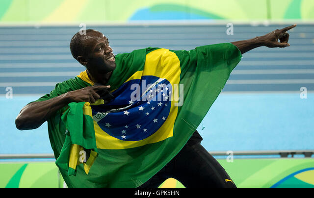 Rio de Janeiro, Brazil. 19th Aug, 2016. USAIN BOLT of Jamaica celebrates with teammates after winning the gold medal - Stock Image