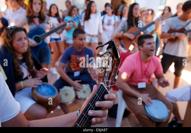 Young catholics playing music - Stock-Bilder