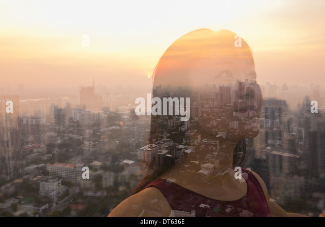 Woman against cityscape, Bangkok, Thailand - Stock Image