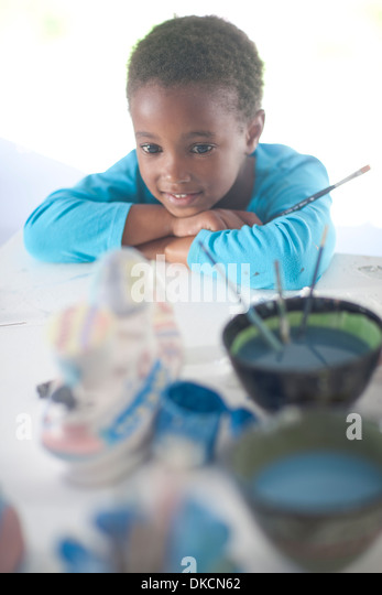 Girl pleased with her artwork - Stock Image