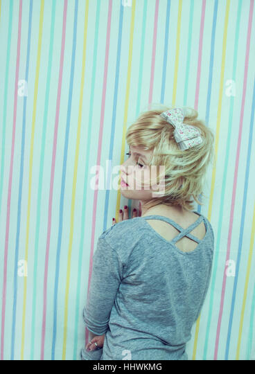 Young blond woman with a sweet look - Stock Image