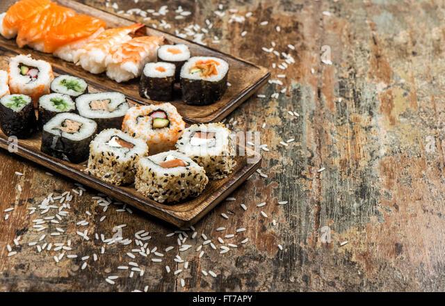 Traditional japanese food. Sushi rolls, maki, nigiri, salmon, shrimp, tuna, tofu, rice, avocado - Stock Image