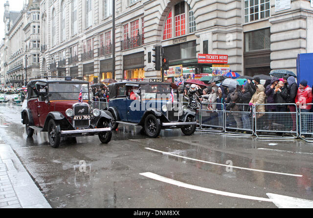 London,UK,1st January 2014,Vintage cars took part in the London's New Year's Day Parade 2014 Credit: Keith - Stock Image