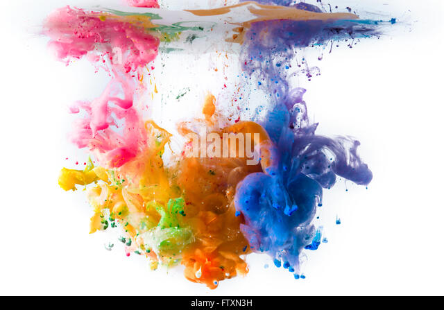 Multi-colored acrylic paints dissolving in water - Stock Image