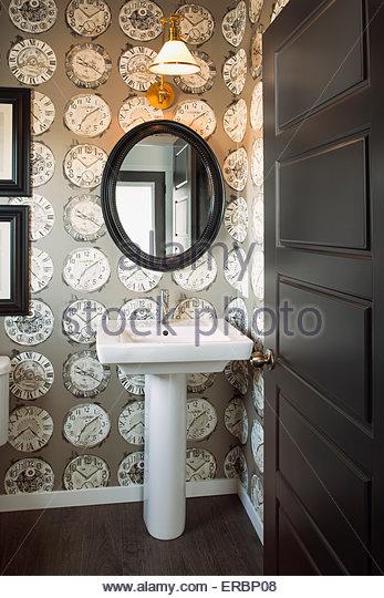 Clock wallpaper in powder bathroom - Stock Image