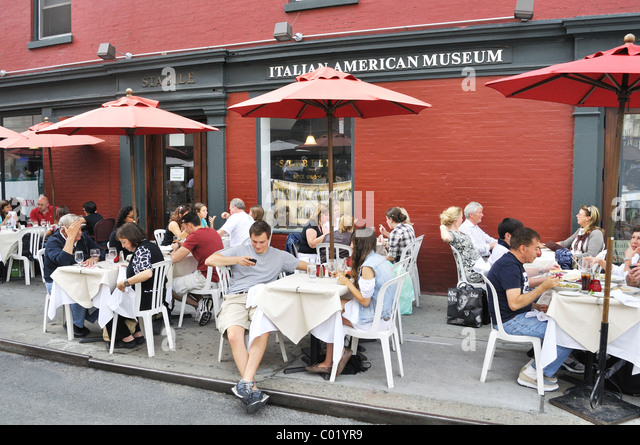 Al fresco lunch at a restaurant on Mulberry Street in Little Italy in New York City. Stock Photo