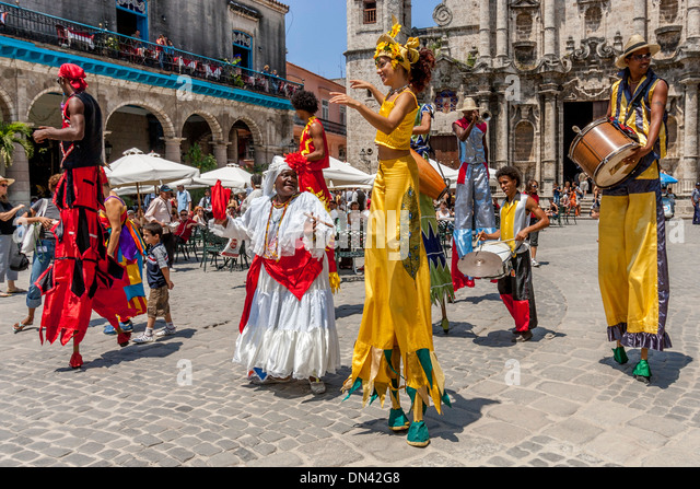 Street Entertainers Dancing On Stilts, Old Havana, Havana, Cuba - Stock Image