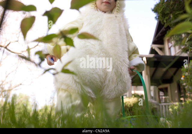 Young boy dressed as Easter bunny - Stock Image