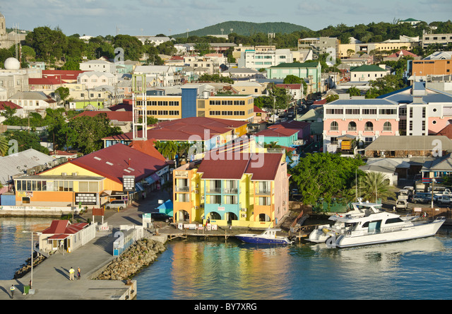 Looking down on the waterfront and Hereitage Quay at St Johns, Antigua from Caribbean cruise ship - Stock Image