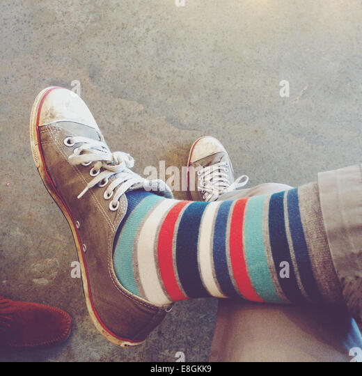 USA, Tennessee, Davidson County, Nashville, Legs in crazy socks - Stock Image