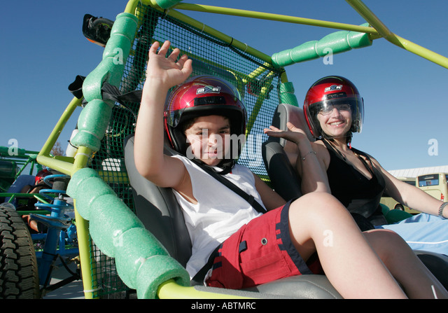 Grand Turk Cockburn Town Cruise Center dune buggy tour vehicle mother son helmets - Stock Image