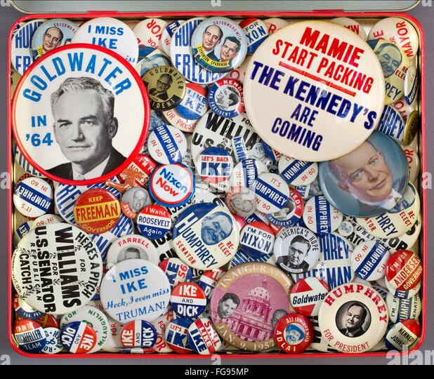 A container full of 1950s and 1960s American political pinback campaign buttons - Stock Image
