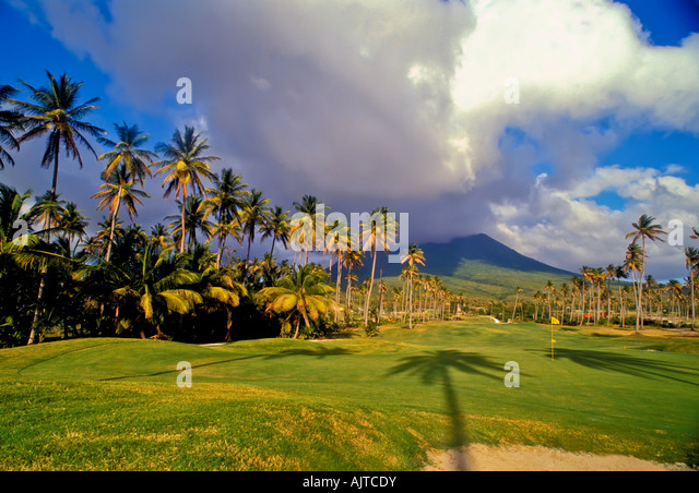 golf course, mt  mount nevis, background, palm trees, four seasons resort, greens,  sand trap, Island of Nevis, - Stock Image