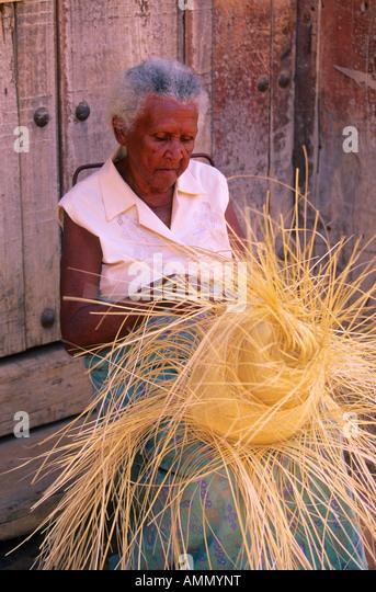Cuban woman weaving hat Trinidad Cuba - Stock Image