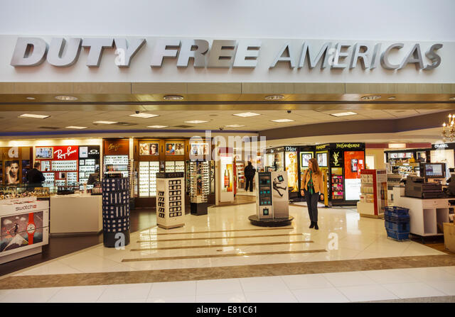 New York New York John F. Kennedy International Airport JFK terminal concourse gate area shopping Duty Free Americas - Stock Image