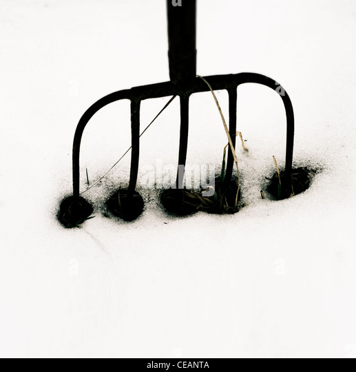 Pitchfork in snow - Stock Image
