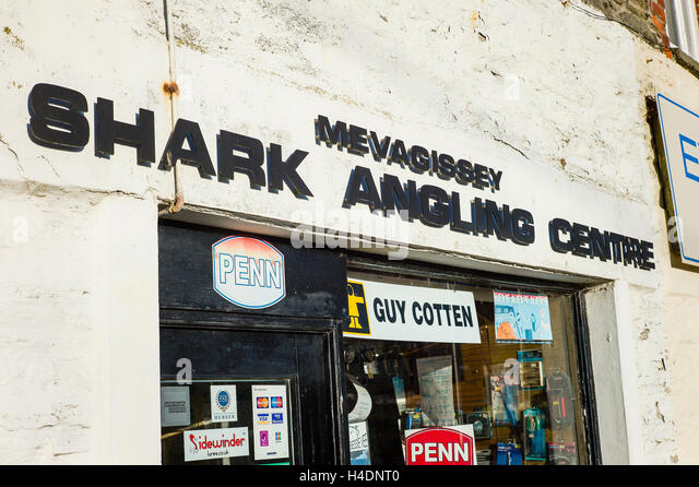 Sign over the Shark Angling Centre in Mevagissey villoage UK - Stock Image