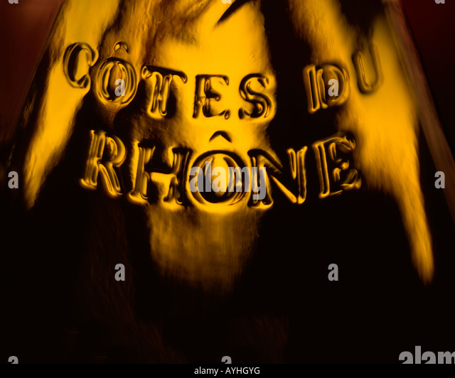 SHOT OF A BOTTLE OF COTES DU RHONE WINE WITH THE AREA OF ORIGIN EMBOSSED INTO THE GLASS - Stock Image