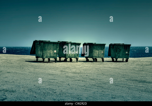 four dumpsters on the shores of the Sea - Stock Image
