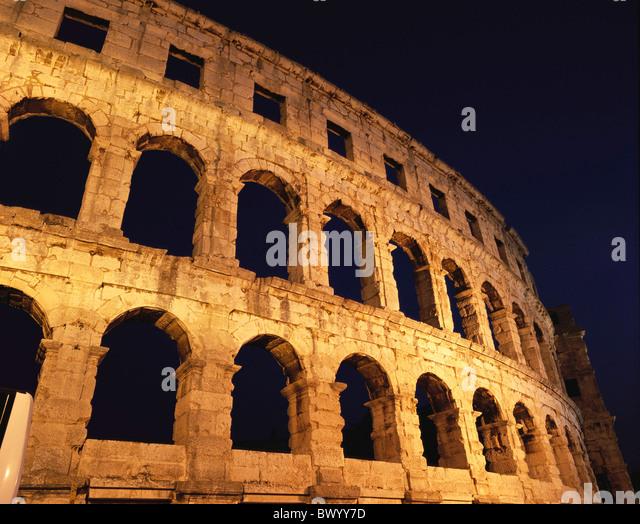 amphitheater Ancient world antiquity arcades detail facade historical Istria Croatia night at night Roman - Stock Image