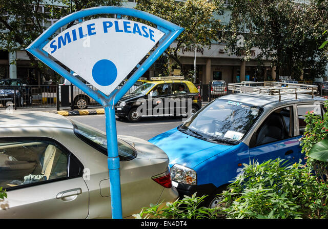 India Asian Mumbai Churchgate Veer Nariman Road sign smile please - Stock Image