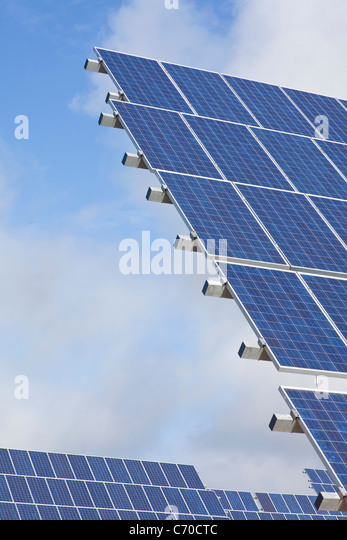 Solar panels against blue sky - Stock Image