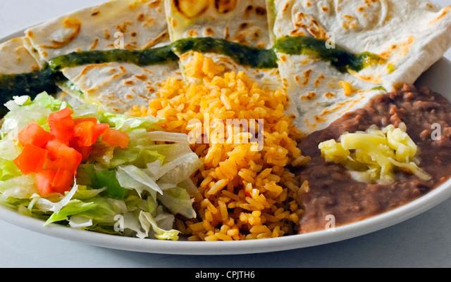 Quesadilla served with salad, rice and refried beans with cheese Stock Photo