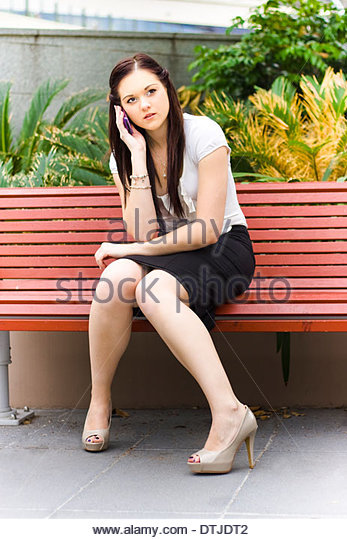 Young Stylish Business Woman Brainstorming A Group Discussion On A Mobile Or Cell Phone During A Teleconference - Stock Image