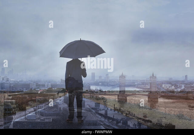 double exposure photo of business man with umbrella and London skyline, panoramic view of the city - Stock Image