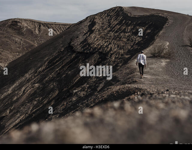 Hiking along the dunes of Death Valley National Park - Stock Image