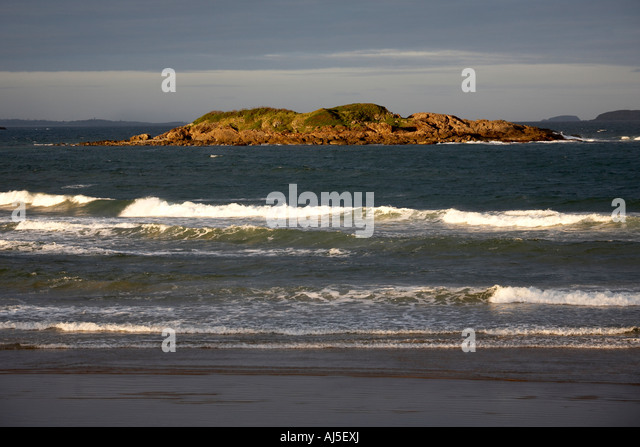 Little Mutton Bird Island in the sea in evening sunlight at Coffs Harbour in New South Wales NSW Australia a - Stock Image