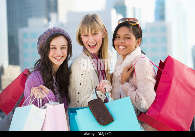 Young women with shopping bags - Stock Image