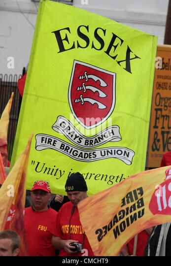 Essex, UK. 18th July 2012. Hundreds of members of the fire service march waving banners and flags in a 24 hour strike. - Stock Image