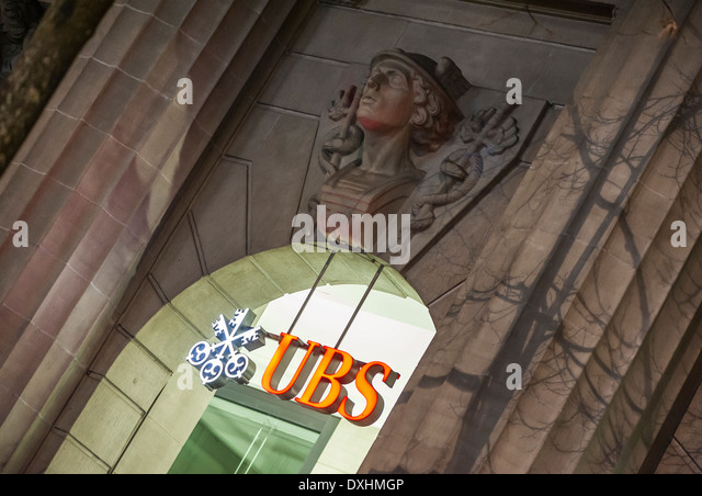Entrance of UBS, Switzerland's largest bank in Zurich, Switzerland at night. - Stock Image